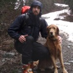 """My dog and I, """"skiing"""" near the head of Indian Arm"""