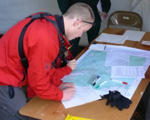 SAR Member using a map